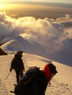 Descending the Bosses arete at sunset after climbing from the Belle Vue that morning. Bad weather blowing in.