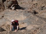 Scrambling to the top of Kouaouch<br>© TraceyR