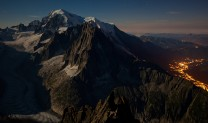 Full moon over the Mont Blanc massif from below the Summit of Les Drus. Chamonix on right