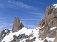 Climber on the crux slab, Cosmiques Arete
