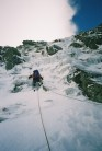 Ben Rule leading up the ice band at the bottom of the Eastern Buttress on the Black Ladders