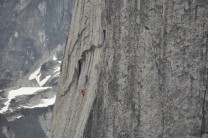 Two Canadian guides high on the Lotus Flower Tower approaching the 3ft roof crux pitch.