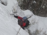 Alex pulling over the final section of pitch 1