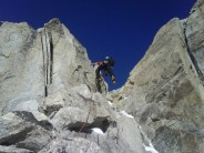 Racing up the easy rock near the top of the Kuffner Arete, Mont Maudit.