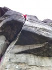 Me climbing Robin Hood's Right-hand Buttress Direct at Stanage Popular (Derbyshire) inverted V