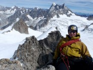 Jimbo on the third summit of the Lachenal, showing the traverse in the background.