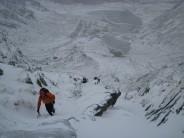 Heading up the final snow gulley of Idwal Stream