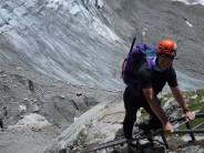 Tom Shaw on ladders above Tre-la-tete Glacier on route to Refuge Conscrits. Prior to Domes Des Miage Traverse