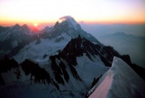 An alpine dawn: looking out from the snow arete on the Brenva spur