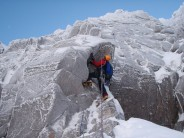 Preparing for the crux on Shadow Buttress A