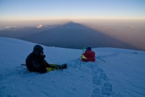 Taking a rest and chatting to base camp. Muztagh Ata summit day, circa 7,150m