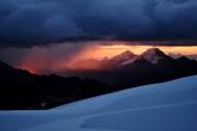 A distant storm approaches Alpamayo base camp<br>© Makalu