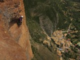 Climbers high above Riglos village on the Murciana route<br>© ali k