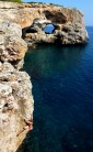 Emma deep water soloing in Cala Sa Nau Mallorca