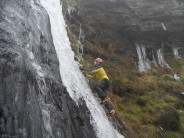 Ian Durham enjoying creaky ice on the upper pitch of the Water Slides, Ratten Clough, Lancashire.