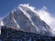 Approaching Kala Patthar as its bathed by the sunrise, Pulmori in the background