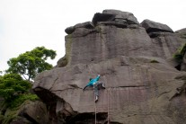 Stretching for the hold on Eraser Slab at Earl Crag