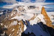 Arête de Rochefort with tiny climbers leading to Dent du Géant. In the background Mt. Blanc.<br>© Ulrik Hasemann