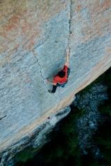 Chrissi Igel fighting his way up a stunning 7b crack pitch at Medji, Switzerland.