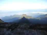 Sri Pada Summit at sunrise with peak's shaddow.