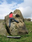 Rachel Hunt showing some of the fun to be had on the EM CM boulder, Little Almscliff.
