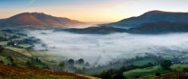 Mist hangs over St johns in The Vale as dawn reaches Blencathra