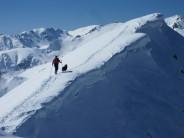 One man and his dog. Cima Pastronezze, 2300m Lagorai Range, Italy. Ski Touring