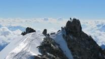 Two climbers summiting