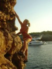 Emma deep water soloing in Mallorca