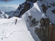 Hank traversing to first anchor of Whymper Couloir, followed by 15 abseils.