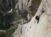 Looking down the South Face of the Marmolada at a Dutch pair on the crux of Don Quixote.<br>© James Rushforth