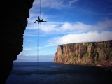 Becky doing her aerial abseiling routine on the Old Man of Hoy!<br>© Jon Garside