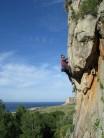 Brian Watson on-sighting Rabbit Hole 6c San Vito lo Capo Salinella