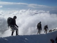 The french army on descent along the exposed snow ridge at the summit