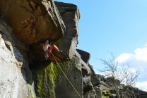 Jamming the roof crack of Strapiombo E1 5b