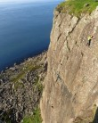Climbers enjoying sunshine and quality routes at the annual Fair Head meet