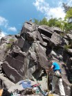 Pete Trickey topped out on Silverback, belayed by Dave Williams