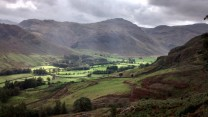 Sunlight on a brooding day in Langdale