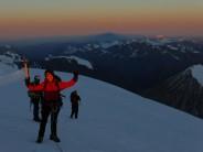 The joy of mountaineering. First sunlight on summit ridge of Mount Khuiten, Mongolia.