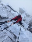 Pulling up to the belay point just below the pinnacle