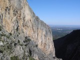 Gubia West Face with a climber on the long finishing ridge of the route Albahida (4+) on Sa Gubia, Mallorca<br>© Alan James