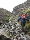 Scrambling up the boulder filled gully to Foxes Tarn