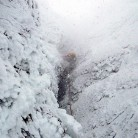 Full-on Scottish conditions. Spindrift on Winter Chimney (V,5), Ben Nevis
