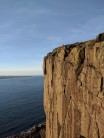 Rory following Saul up the second pitch of Wall of Prey on a sunny April evening.