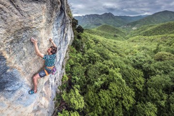 Rob Greenwood enjoying compact rock at Bausu Centrale in Oltre Finale