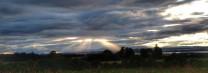 Angel rays through stormy skies