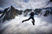 Tim Howell enjoying a birthday BASE jump off the 3600m summit of the Trident du Tacul down into the Cirque Maudit, 240m below<br>© Hamish Frost