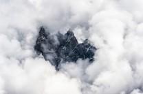 Afternoon clouds surround the Aiguille de Blaitière, Aiguille des Ciseaux, Aiguille du Fou in the Mont Blanc region of F