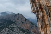 """Michael Schreiber climbs """"Goliath"""" 8b, a 60m long pitch at the impressive sector of Elona, Leonidio / Greece<br>© Andreas Markou"""