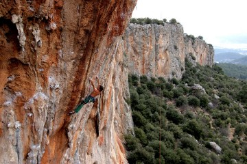 Entering the crux of Colonist, Geyikbayiri, Turkey. Thanks to Ben Crawford for the photo!